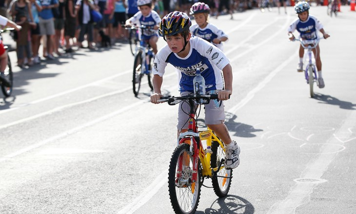 Tamariki boys on bmx bikes racing on the road