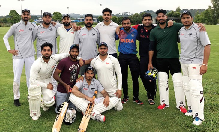 Cricketers pose for a team shot